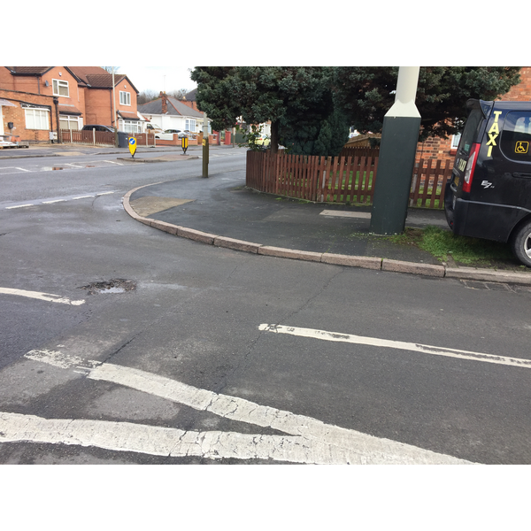 Deep Dale in Evington Ward. Liberal Democrats reported to Leicester City Council the pothole forming at the junction with the busy Green Lane Road