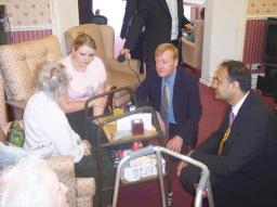 Parmjit Gill and Charles Kennedy visiting elderly in Leicester