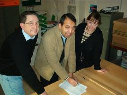 (left to right) Jeff Stephenson with Zuffar Haq & Councillor Debbie Almey signing the petition.