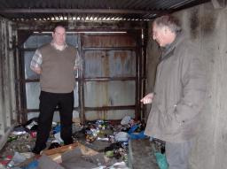 Peter Coley with Simon Sansome inspecting criminal damage