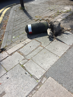Upturned bollard on Fosse Road South, close to the junction with Hinckley Road, Leicester.
